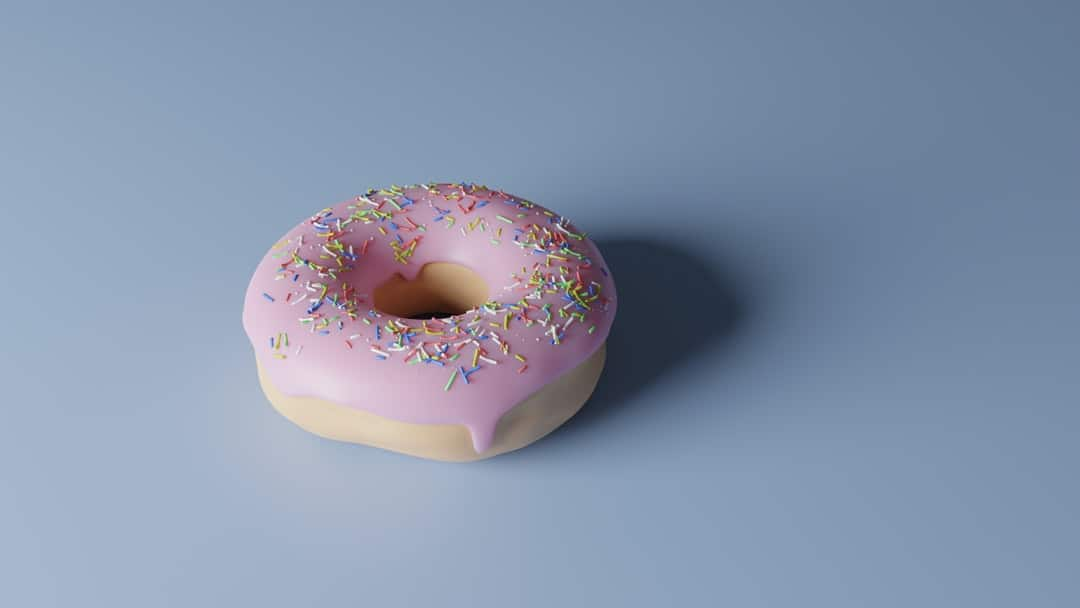 A donut sitting on top of a table