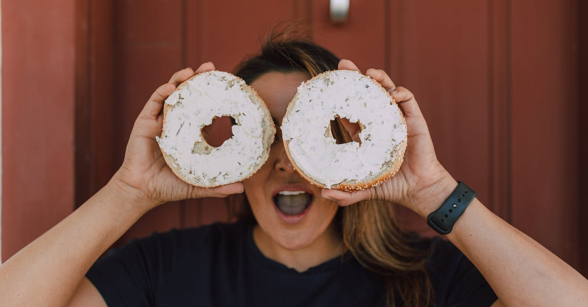 A person holding a donut